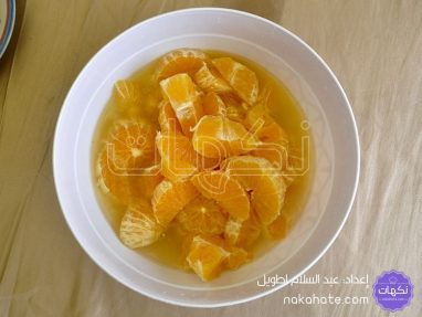 إضافة البرتقال والقليل من الماء